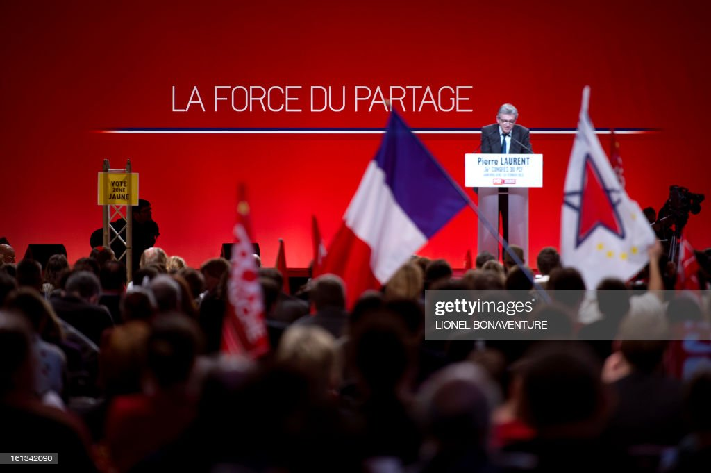 French Communist Party (PCF) national secretary Pierre Laurent (R) delivers a speech on February 10, 2013, closing the 36th Congress of the French Communist Party in Saint-Denis, north of Paris. Pierre Laurent, 55, the sole candidate to his own succession was re-elected as the PCF's national secretary with 100 percent of the 624 votes.