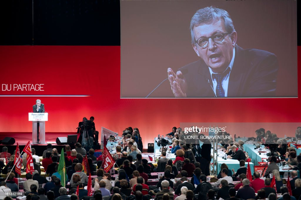 French Communist Party (PCF) national secretary Pierre Laurent (L) delivers a speech on February 10, 2013, closing the 36th Congress of the French Communist Party in Saint-Denis, north of Paris. Pierre Laurent, 55, the sole candidate to his own succession was re-elected as the PCF's national secretary with 100 percent of the 624 votes.