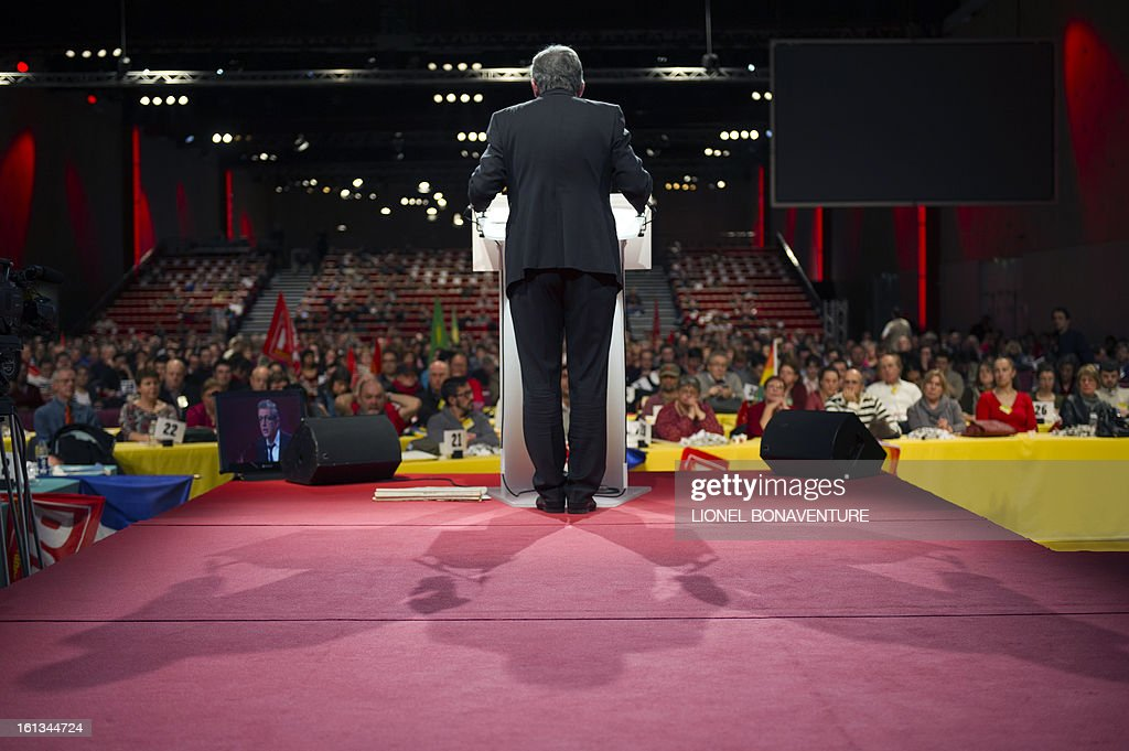 French Communist Party (PCF) national secretary Pierre Laurent (C) delivers a speech on stage on February 10, 2013, closing the 36th Congress of the French Communist Party in Saint-Denis, north of Paris. Pierre Laurent, 55, the sole candidate to his own succession was re-elected as the PCF's national secretary with 100 percent of the 624 votes. AFP PHOTO / LIONEL BONAVENTURE