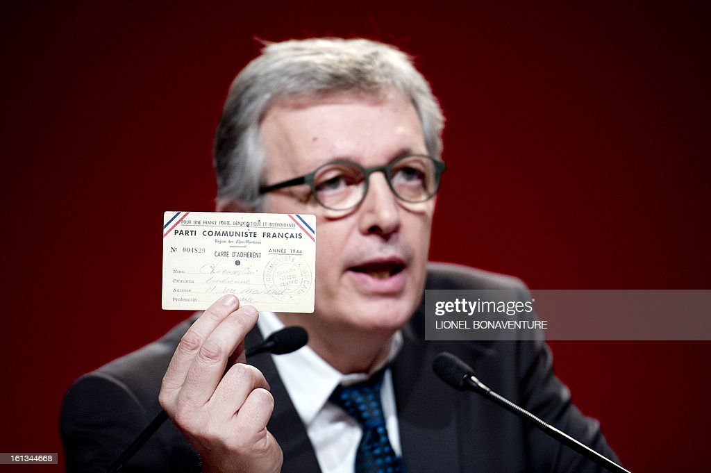 French Communist Party (PCF) national secretary Pierre Laurent holds the former PCF membership card on February 10, 2013, during his speech closing the 36th Congress of the French Communist Party in Saint-Denis, north of Paris. Pierre Laurent, 55, the sole candidate to his own succession was re-elected as the PCF's national secretary with 100 percent of the 624 votes. Laurent intended to prove that former PCF membership cards, as well as the new ones, did not show the communist hammer and sickle symbols. AFP PHOTO / LIONEL BONAVENTURE