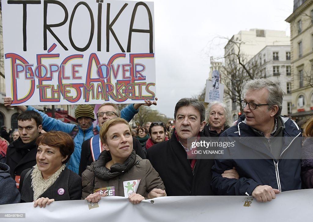 French Communist Party (PCF) national secretary Pierre Laurent (R), leftist Front de Gauche (FG) leader <a gi-track='captionPersonalityLinkClicked' href=/galleries/search?phrase=Jean-Luc+Melenchon&family=editorial&specificpeople=635097 ng-click='$event.stopPropagation()'>Jean-Luc Melenchon</a> (2nd R), and spokesperson of French Left party Ensemble (Together) Clementine Autain (2nd L) march during a demonstration in support of the Greek people on February 15, 2015 in Paris. At least 2,000 people marched through the streets of Paris on February 15 heeding the call from unions and far-left organisations to voice their support for Greece and its new leftist anti-austerity government. AFP PHOTO / LOIC VENANCE
