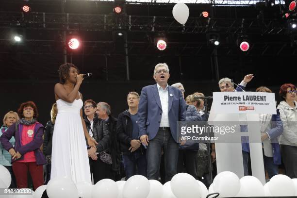 French Communist Party national secretary Pierre Laurent sings during the 82nd edition of the annual 'Fete de l'humanite' music festival organized by...