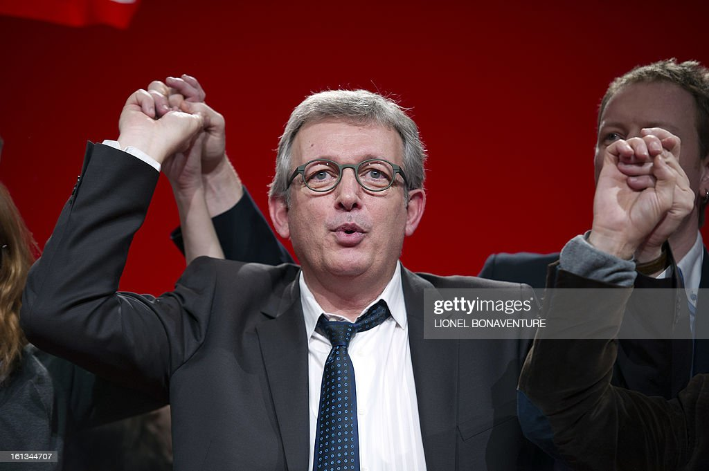 French Communist Party (PCF) national secretary Pierre Laurent sings France's national anthem La Marseillaise on February 10, 2013, after his speech closing the 36th Congress of the French Communist Party in Saint-Denis, north of Paris. Pierre Laurent, 55, the sole candidate to his own succession was re-elected as the PCF's national secretary with 100 percent of the 624 votes.