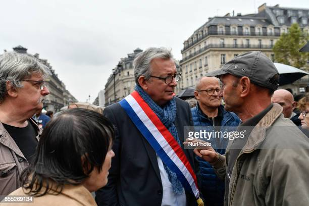 French Communist Party national secretary Pierre Laurent speak with protesters during a demonstration in Paris on September 28 2017 against the...