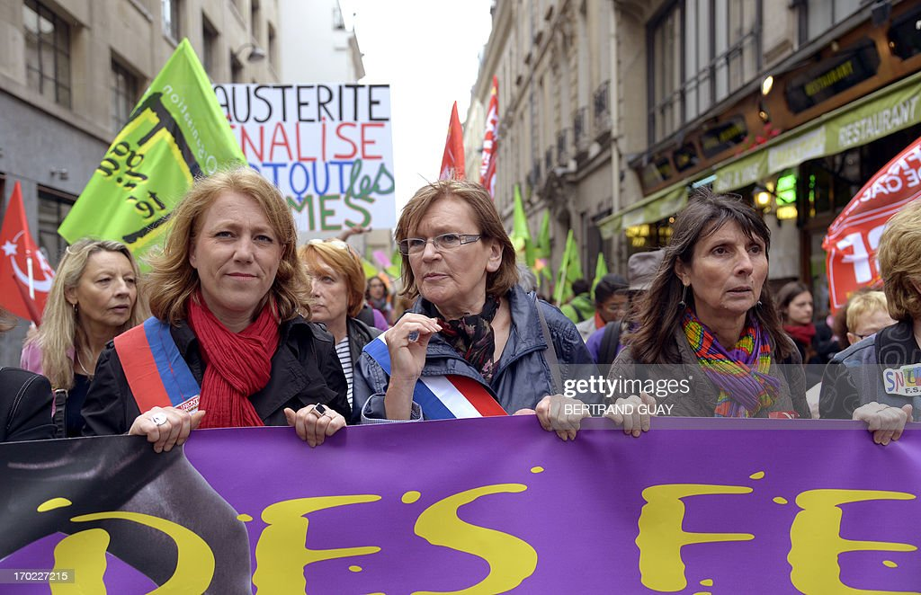 French Communist Party's (PCF) member of parliament Marie-George Buffet (C) takes part in a demonstration called by feminist organizations to denounce the government's economic austerity measures, which they say 'women are the first victims of' on June 9, 2013 in Paris.