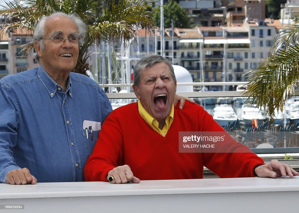 French composer Michel Legrand (L) and US comedian Jerry Lewis pose on May 23, 2013 during a photocall for the film 'Max Rose' presented Out of Competition at the 66th edition of the Cannes Film Festival in Cannes. Cannes, one of the world's top film festivals, opened on May 15 and will climax on May 26 with awards selected by a jury headed this year by Hollywood legend Steven Spielberg.