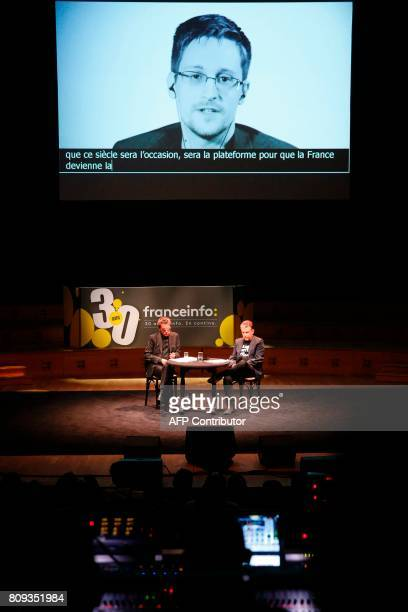 French composer performer and record producer JeanMichel Jarre and French journalist Philippe Vandel sit on stage as US intelligence contractor and...