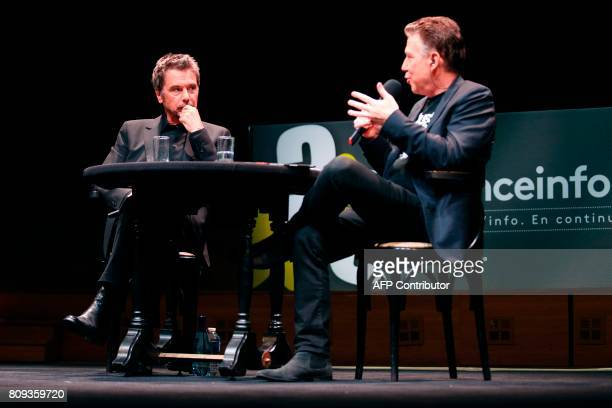 French composer performer and record producer JeanMichel Jarre and French journalist Philippe Vandel speak on stage during a masterclass at the...