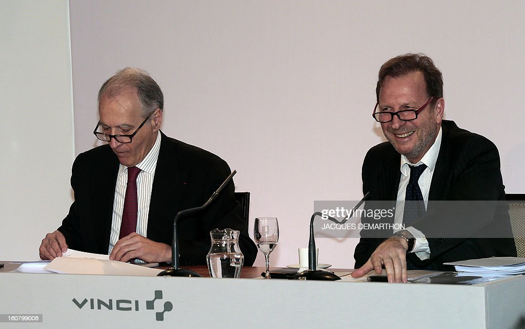 French concession and construction group Vinci chairman, Xavier Huillard, and executive vice-President and Chief Financial Officer, Christian Labeyrie, take part in the group's general meeting in Paris on February 6, 2013. Vinci share price lost 2,53 per cent at 35,69 euros. Placard reads : 'Real success is the one you share'.