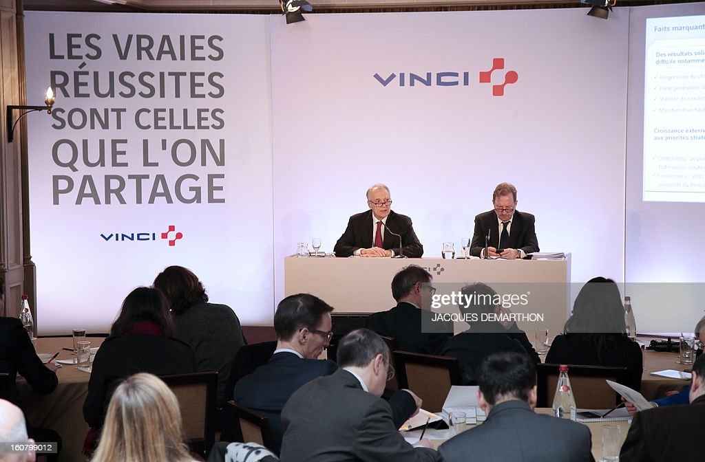 French concession and construction group Vinci chairman, Xavier Huillard, and executive vice-President and Chief Financial Officer, Christian Labeyrie, take part in the group's general meeting in Paris on February 6, 2013. Vinci share price lost 2,53 per cent at 35,69 euros. Placard reads : 'Real success is the one you share'. AFP PHOTO/JACQUES DEMARTHON