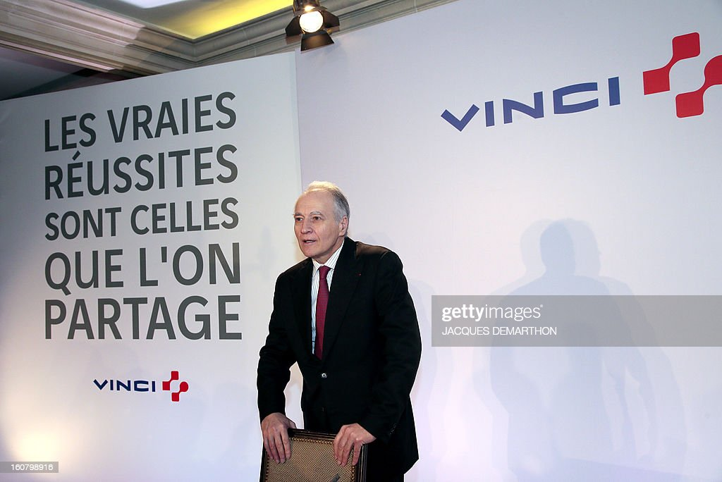 French concession and construction group Vinci chairman Xavier Huillard poses during the group's general meeting in Paris on February 6, 2013. Vinci share price lost 2,53 per cent at 35,69 euros. Placard reads : 'Real success is the one you share'.
