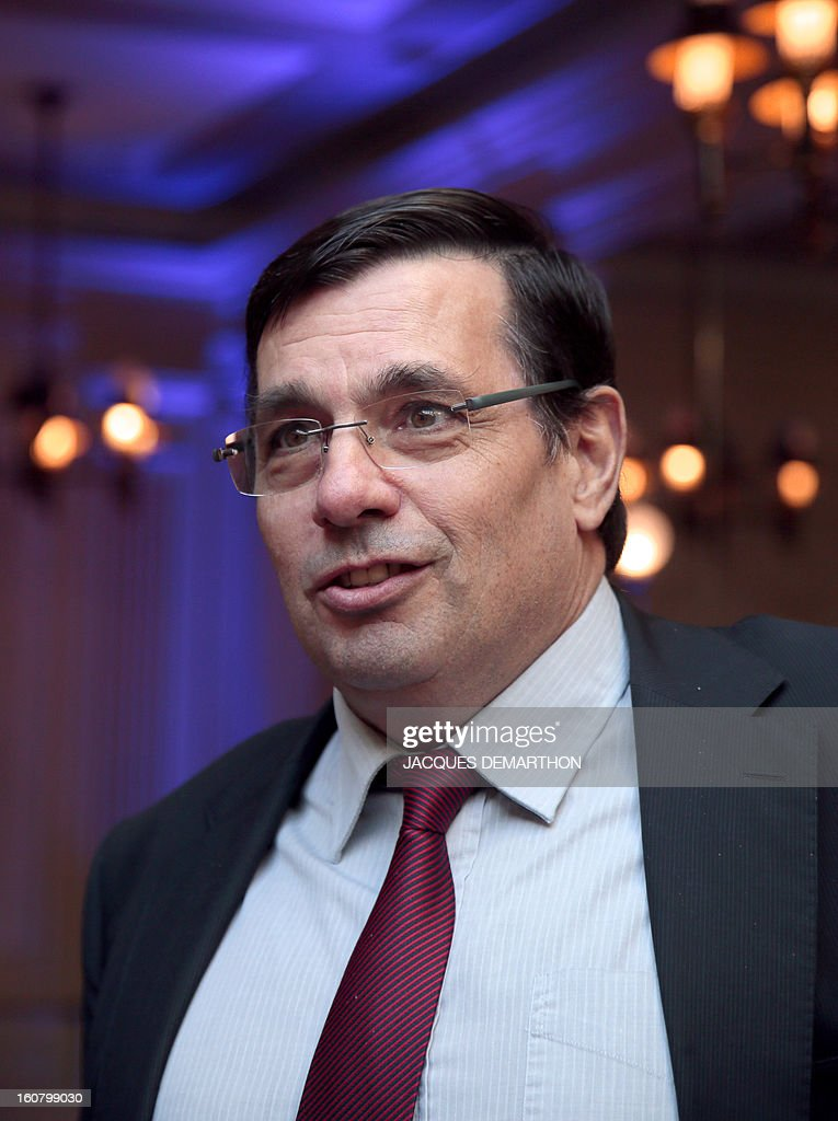 French concession and construction group Vinci Energy's President, Yves Meignie, looks on during the group's general meeting in Paris on February 6, 2013. AFP PHOTO/JACQUES DEMARTHON