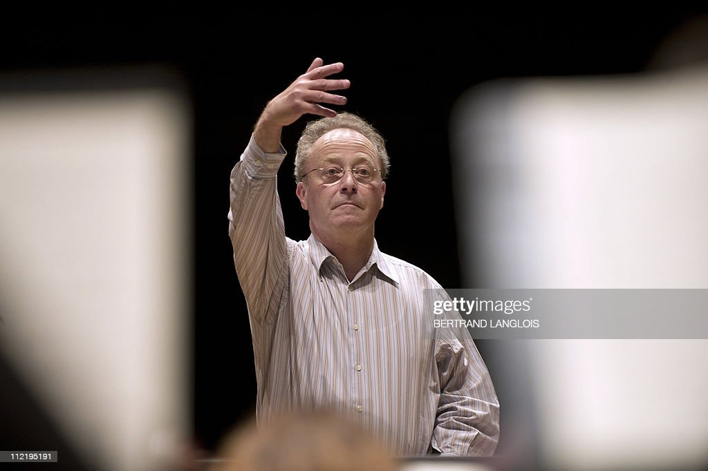 French conductor Emmanuel Krivine leads a rehearsal of the Ludwig van Beethoven's Fourth Symphony on April 14, 2011 at the Cite de la Musique concert hall in Paris. Krivine, an ardent defender of the authenticity of Beethoven's work, is presenting an integral of the symphonies performed with period instruments in 5 concerts from April, 14 to April 17, 2011 in Paris.