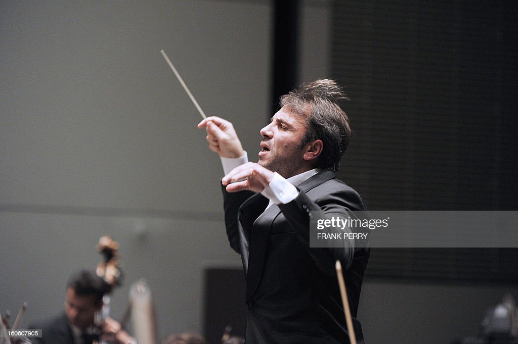 French conductor Fayçal Karoui performs Maurice Ravel's Bolero with the 'Orchestre Lamoureux' on February 3, 2013, as part of the 'Folle Journee' music festival at the Cite des Congres in Nantes.
