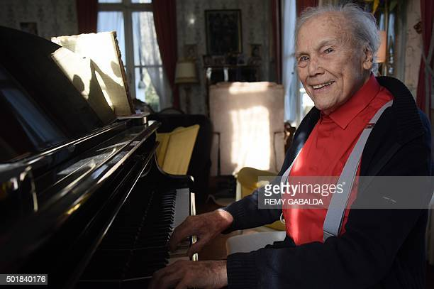 French conductor Georges Pretre plays piano in his castle on December 10 2015 in Naves southern France Georges Pretre led the New Year's concert in...