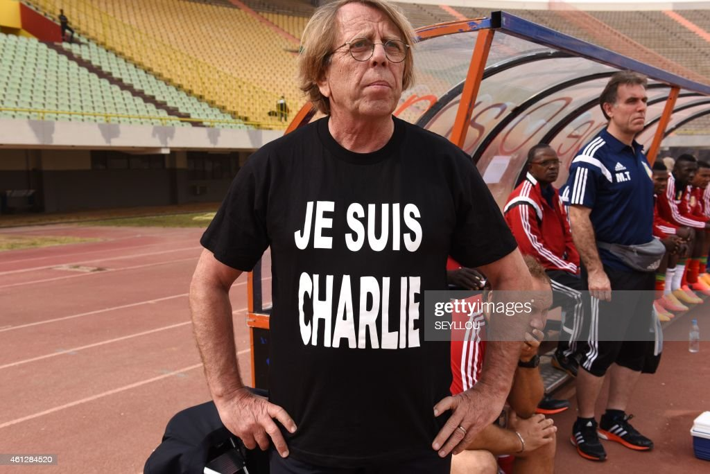 French Congo's head coach <a gi-track='captionPersonalityLinkClicked' href=/galleries/search?phrase=Claude+Le+Roy&family=editorial&specificpeople=790794 ng-click='$event.stopPropagation()'>Claude Le Roy</a> wears a t-shirt reading in french 'I am Charlie' in solidarity with the victims of the deadly shooting at the Paris office of the satirical newspaper Charlie Hebdo during a friendly game between Congo and Cape Verde on January 10, 2015 at the Leopold Sedar Senghor stadium in Dakar, Senegal, ahead to the Africa Cup of Nations 2015 which begins on January 17 until February 8.