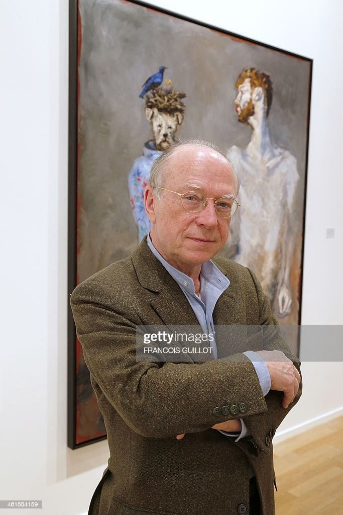 French contemporary and modern art dealer Daniel Templon poses in front of one of French painter Gerard Garouste's works, on January 9, 2014 in Paris, prior to a new exhibition organized at the Templon Galerie from January 11 to February 26. AFP PHOTO FRANCOIS GUILLOT CAPTION