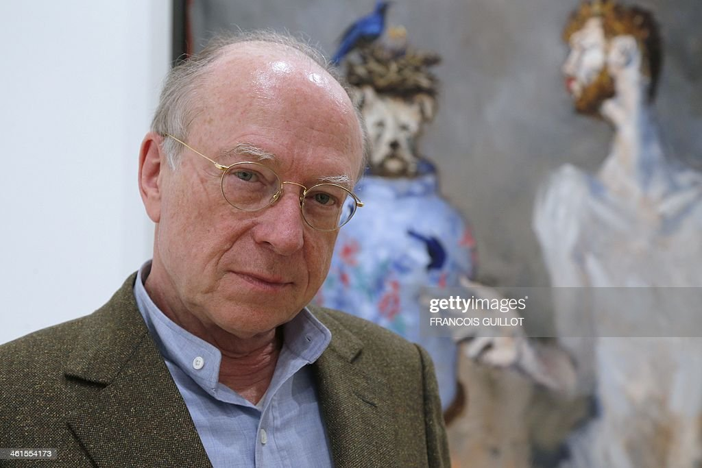 French contemporary and modern art dealer Daniel Templon poses in front of one of French painter Gerard Garouste's works, on January 9, 2014 in Paris, prior to a new exhibition organized at the Templon Galerie from January 11 to February 26.