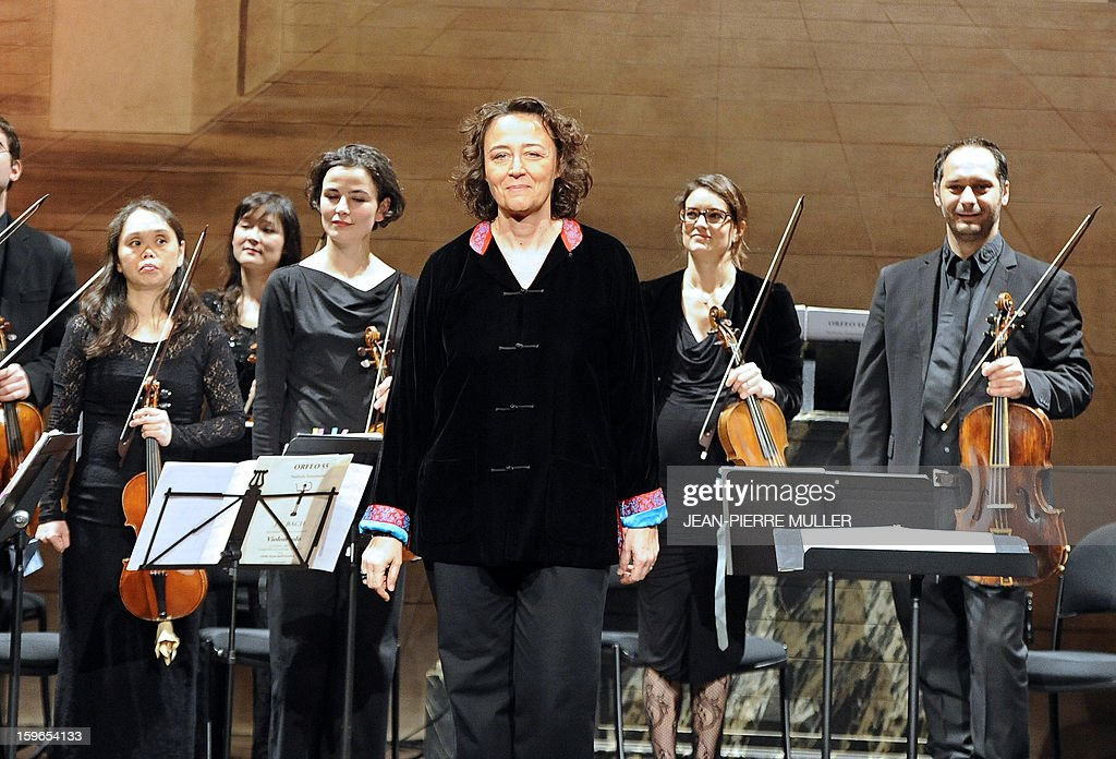 French contralto Nathalie Stutzmann (C) surrounded by her 'Orfeo 55' band greets the audience, on January 15, 2013, at the Bordeaux Opera, southwestern France, after performing a baroque repertoire.