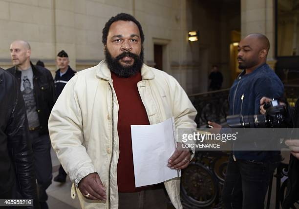 French controversial comic Dieudonne M'bala M'bala arrives at the Paris courthouse on March 12 for the trial of French farright writer Alain Soral...