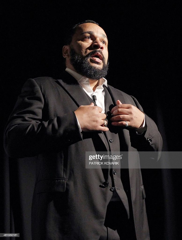 French controversial humorist Dieudonne Mbala Mbala delivers a speech prior to the premiere screening of his movie 'Antisémite' (Anti-Jewish) on January 15, 2012 on the stage of the 'Main d'Or' theatre in Paris.