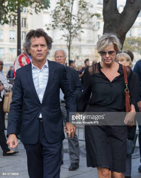 French Cook Chief Guy Martin and his wife Katherina Marx attend Mireille Darc's Funeral at Eglise Saint Sulpice on September 1 2017 in Paris France...