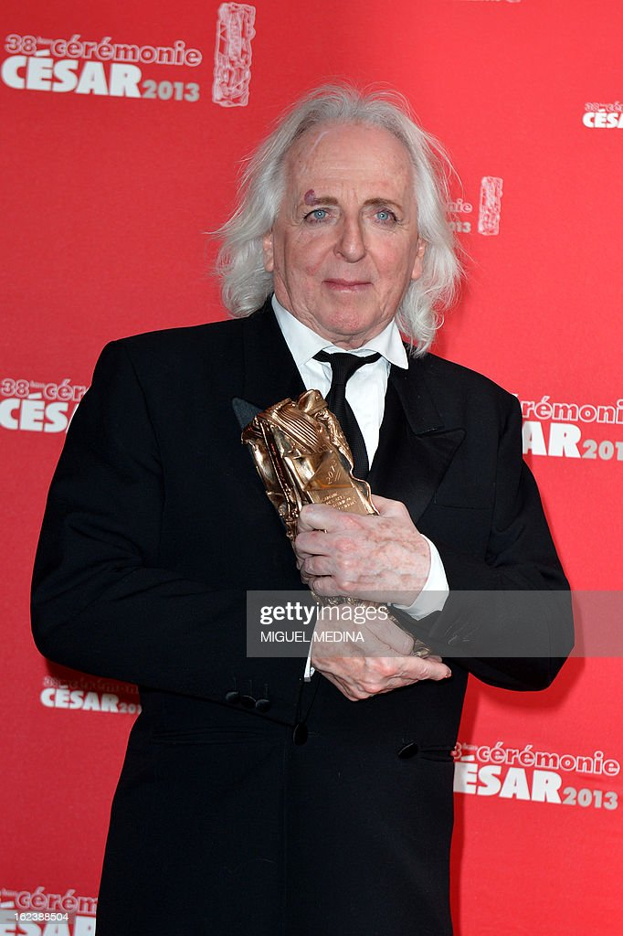 French costume designer Christian Gasc poses with his trophy after receiving the Best Costume Design award for French director Benoit Jacquot's film 'Les adieux a la reine' (Farewell my queen)during a photocall at the 38th Cesar Awards ceremony on February 22, 2013 at the Chatelet theatre in Paris.