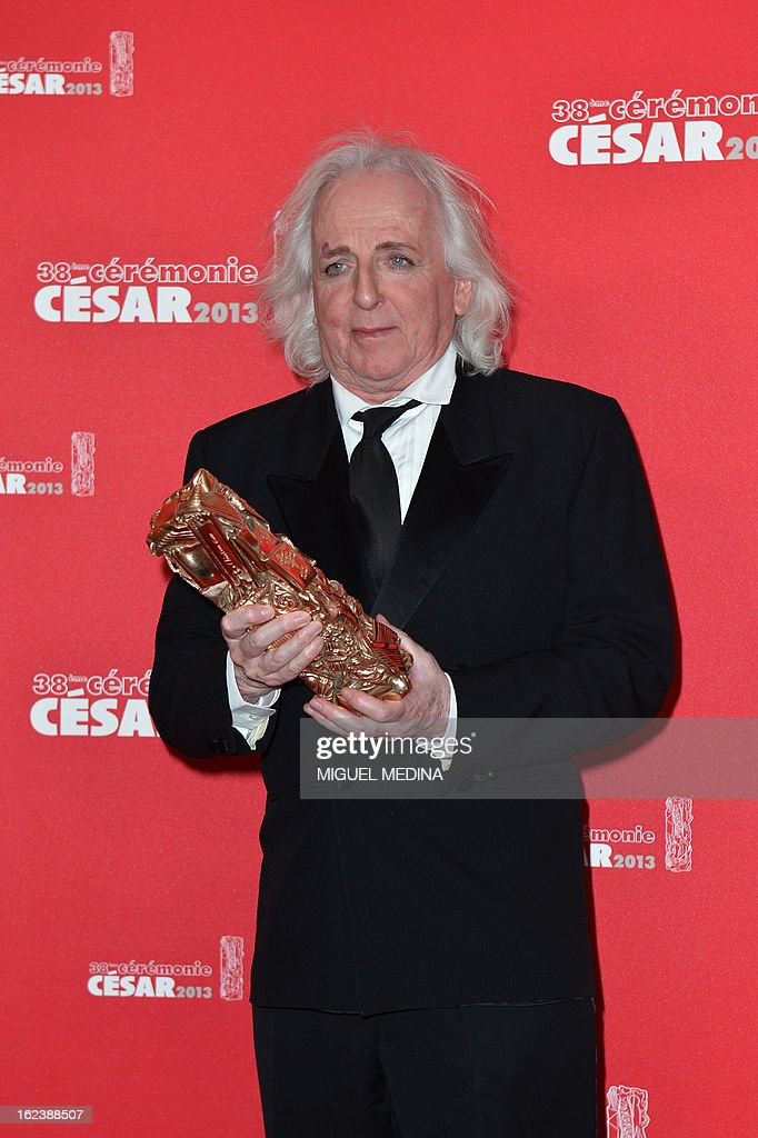French costume designer Christian Gasc poses with his trophy after receiving the Best Costume Design award for French director Benoit Jacquot's film 'Les adieux a la reine' (Farewell my queen) during a photocall at the 38th Cesar Awards ceremony on February 22, 2013 at the Chatelet theatre in Paris.