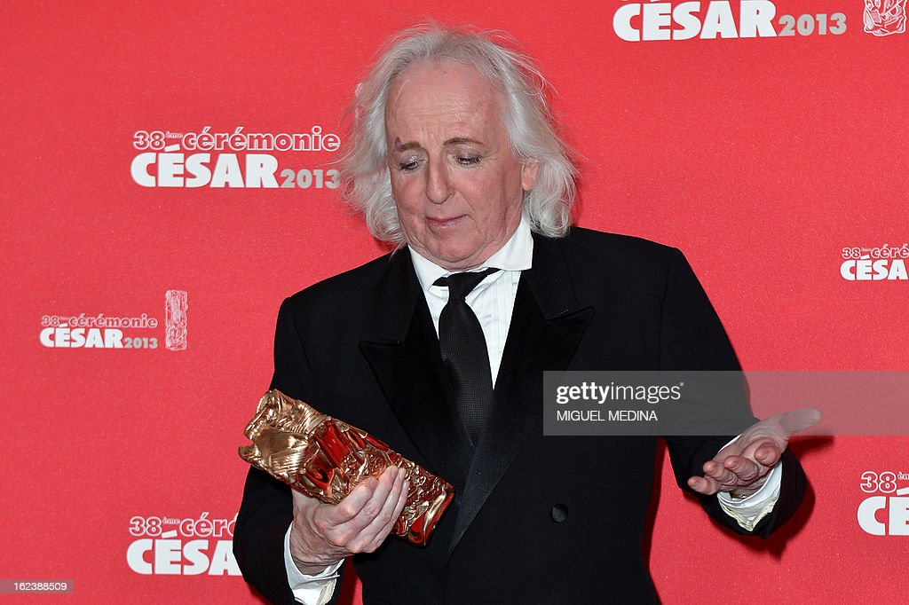 French costume designer Christian Gasc poses with his trophy after receiving the Best Costume Design award for French director Benoit Jacquot's film 'Les adieux a la reine' (Farewell my queen) during a photocall at the 38th Cesar Awards ceremony on February 22, 2013 at the Chatelet theatre in Paris. AFP PHOTO / MIGUEL MEDINA