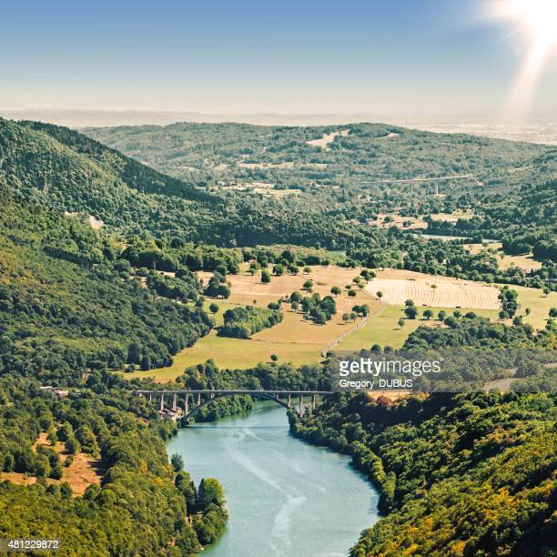 French countryside river aerial view in summer by bright sunset