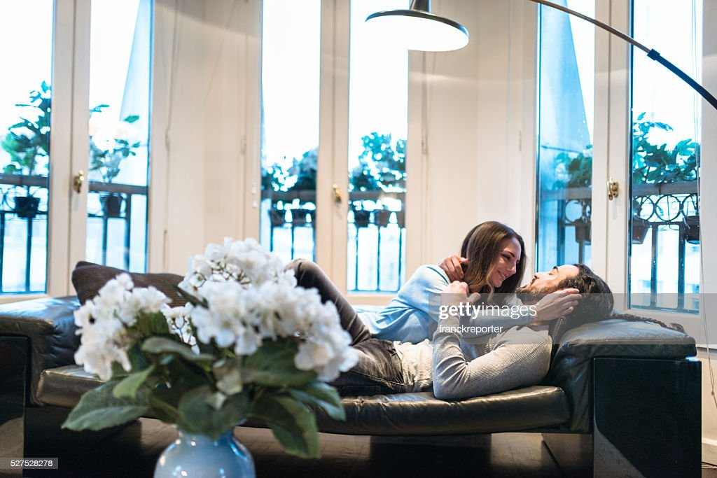 french couple kissing and flirting on the couch stock photo getty images. Black Bedroom Furniture Sets. Home Design Ideas