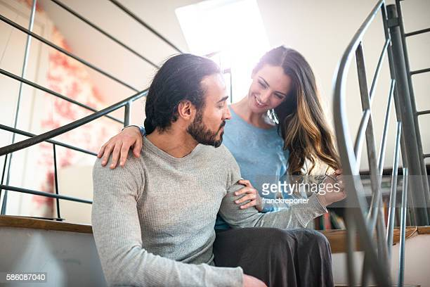 French couple on the step at home