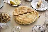 French crepes, thin pancakes on a served wooden table, traditional tea party.