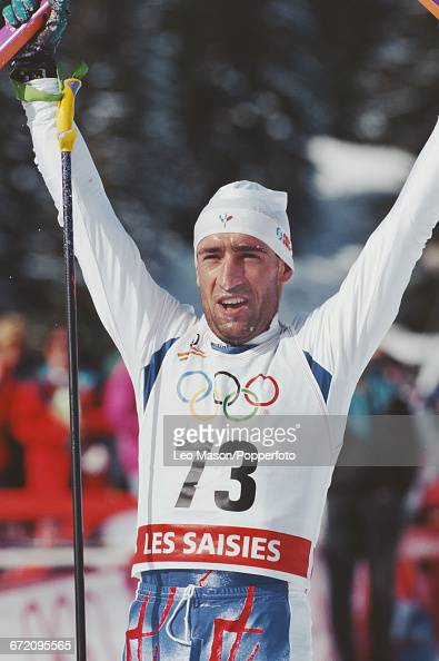 French cross country skier Herve Balland raises his arms in the air in celebration after finishing in 5th place in the Men's 50 kilometres cross...