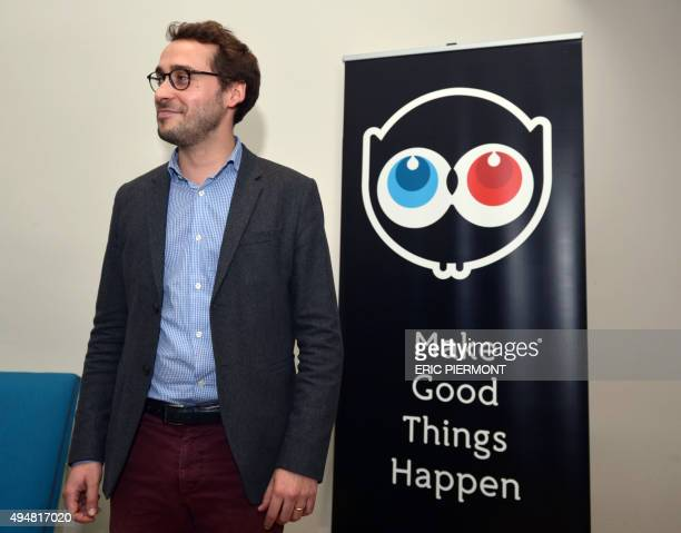 French crowdfunding site Ulule cofounder and Chairman Alexandre Boucherot looks on next to the Ulele logo during a visit of French Finance Minister...