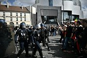 TOPSHOT French CRS antiriot police face protesters on Place de la Bastille during a demonstration against proposed government labour and employment...