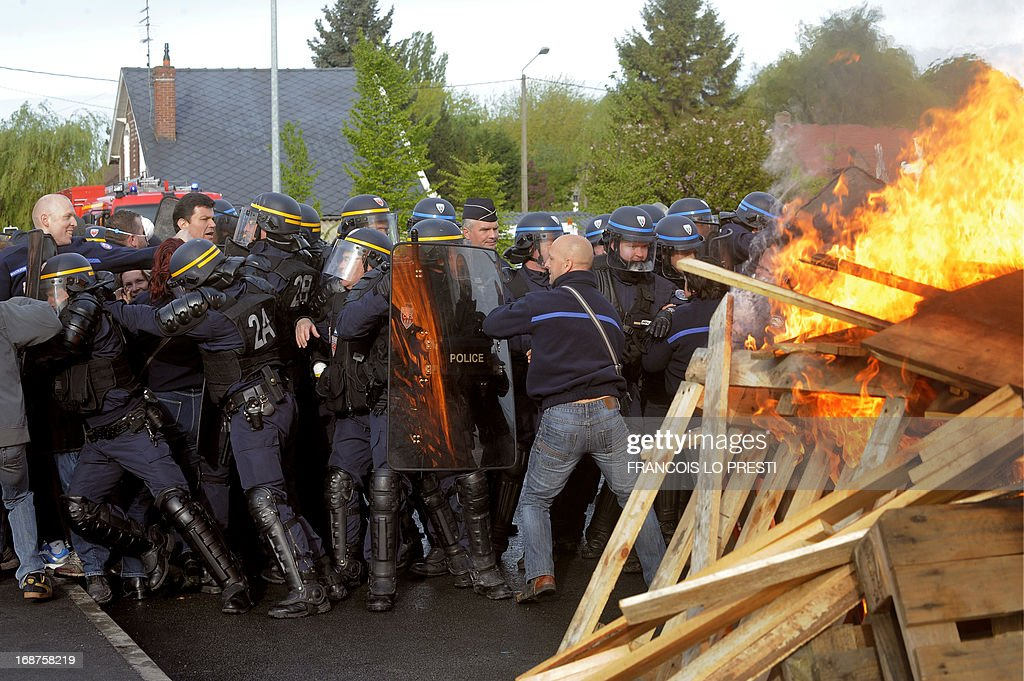 French CRS riot police and police officers clash with prison guards at the Sequedin remand centre, northern France, on May 15, 2013. Prison guards blocked the access to the remand centre for three hours this morning to protest against a lack of security measures at the jail, one month after Redoine Faid's dramatic escape. PRESTI