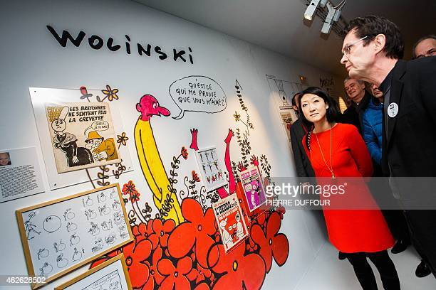 French Culture and Communications Minister Fleur Pellerin visits the exhibition 'Une histoire de Charlie hebdo' in tribute to the French cartoonists...