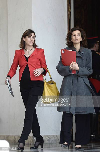 French Culture minister Audrey Azoulay and French junior minister for victims aid Juliette Meadel leave the weekly cabinet meeting on February 17...