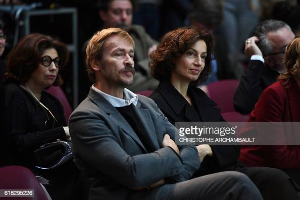 French Culture Minister Audrey Azoulay sits next to Comedie Francaise's general manager Eric Ruf as they attend a briefing on the project to turn the...
