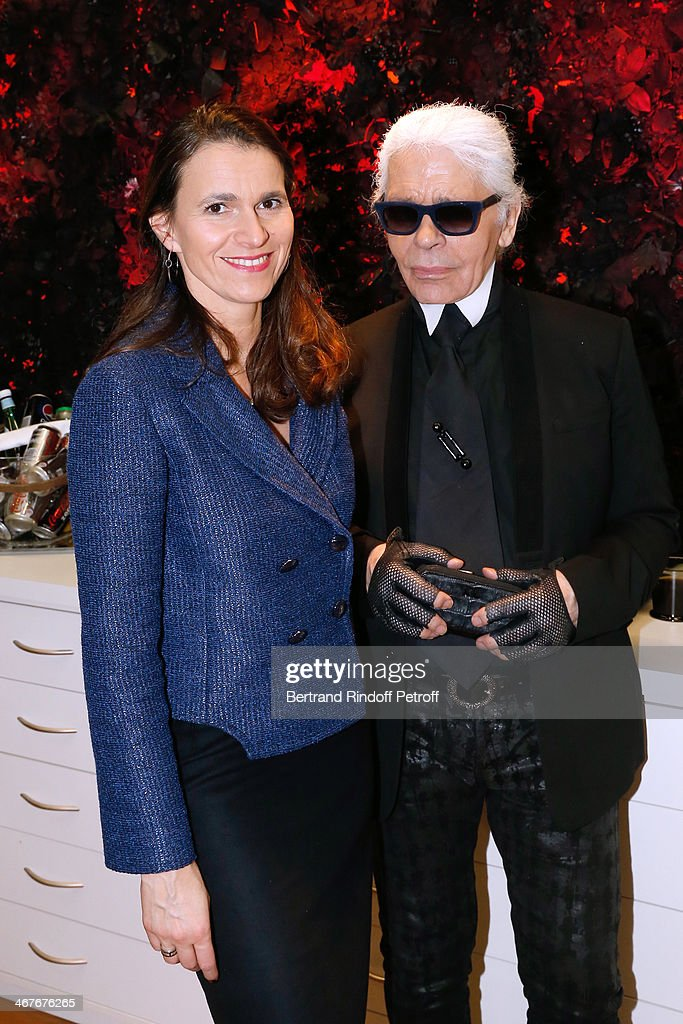 French Culture Minister Aurelie Filippetti and Fashion designer <a gi-track='captionPersonalityLinkClicked' href=/galleries/search?phrase=Karl+Lagerfeld&family=editorial&specificpeople=4330565 ng-click='$event.stopPropagation()'>Karl Lagerfeld</a> at the showroom of 'Maison Lemarie' as they visit 'Les Ateliers d'Art' belonging to 'La Maison Chanel' on February 7, 2014 in Pantin, France.