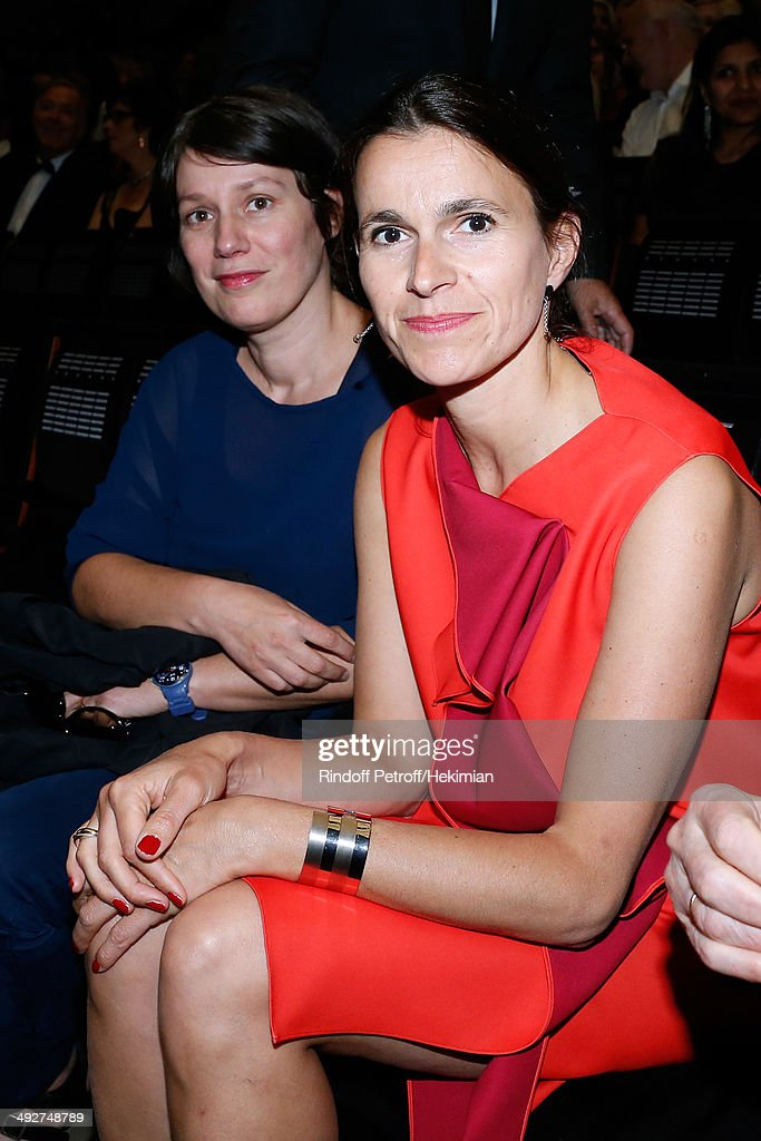 French Culture Minister Aurelie Filippetti (R) and her child friend Celine Caringi attend the AROP Charity Gala. Held at Opera Bastille on May 21, 2014 in Paris, France.