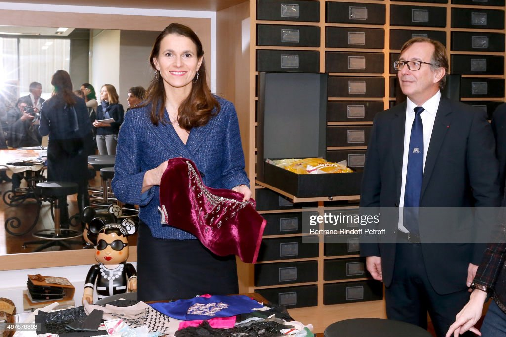 French Culture Minister Aurelie Filippetti and President of Fashion Activities at Chanel Bruno Pavlovsky, in the Archives, attend the Fashion designer Karl Lagerfeld visit at 'Les Ateliers d'Art' belonging to 'La Maison Chanel' on February 7, 2014 in Pantin, France.