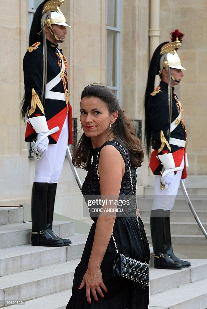 French Culture Minister Aurelie Filippetti arrives for a state dinner at the Elysee presidential palace in Paris, on June 6, 2014, following the international D-Day commemoration ceremony on the beach of Ouistreham, western France, marking the 70th anniversary of the World War II Allied landings in Normandy. AFP PHOTO / PIERRE ANDRIEU