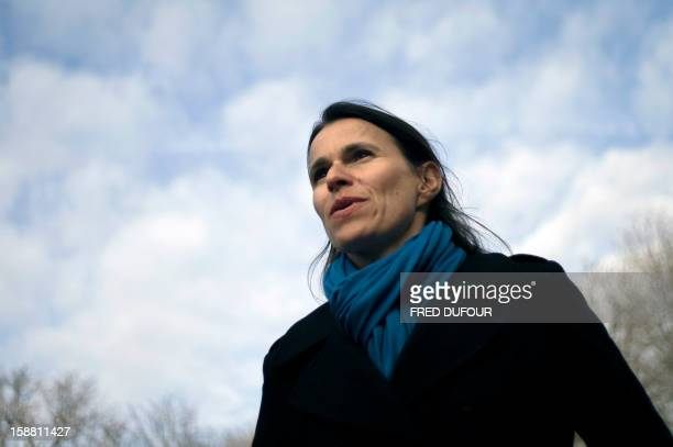 French Culture Minister Aurelie Filippetti arrives to visit the Edward Hopper exhibition at the Grand Palais with people beneficiaries of charity...