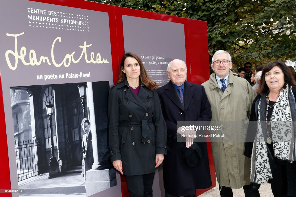 French Culture Minister Aurelie Filippetti, entrepreneur and patron of the arts Pierre Berge, who is the executor of Cocteau's estate, President of the Centre des Monuments Nationaux Philippe Belaval and Jean Cocteau's great-niece Dominique Narqui attend the opening of the exhibition 'Jean Cocteau, A Poet At the Palais Royal' on October 11, 2013 in the gardens of the Palais Royal in Paris, France. The exhibition organized by the Centre des Monuments Nationaux takes part to a national commemoration dedicated to the 50th anniversary of French poet, novelist, playwright, actor, artist and film director Jean Cocteau's death.