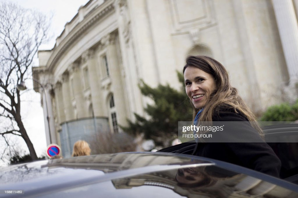 French Culture Minister Aurelie Filippetti leaves the Grand Palais after visiting the Edward Hopper exhibition with people beneficiaries of charity organizations on December 30, 2012 in Paris. Some 400 beneficiaries of French charity organisations Emmaüs, the Restos du Coeur, the French Red Cross and the Secours Populaire, were invited to visit some of Paris' biggest exhibitions during this one-day event, entitled 'Musees populaires, musees solidaires' (popular museums, committed museums).