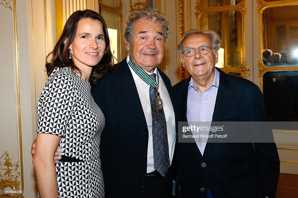 French Culture Minister Aurelie Filippetti, Pierre perret and journalist Bernard Pivot attend singer Pierre Perret receives the insignia of Commander of the Order of Arts and Letters at 'Ministere de la Culture' on July 9, 2014 in Paris, France.