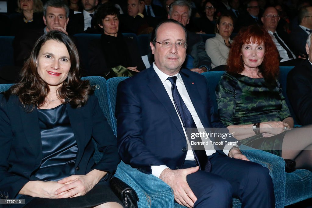 French Culture Minister Aurelie Filippetti, President of the French Republic Francois Hollande and actress Sabine Azema attend the 'Aimer, Boire Et Chanter' Paris movie premiere. Held at Cinema UGC Normandie on March 10, 2014 in Paris, France.