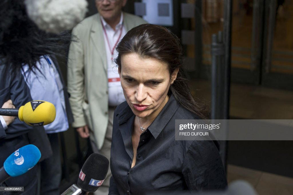 French Culture minister Aurelie Filippetti speaks to journalists as she arrives to attend the French Socialist (PS) ruling-party national council on June 14, 2014 in Paris.